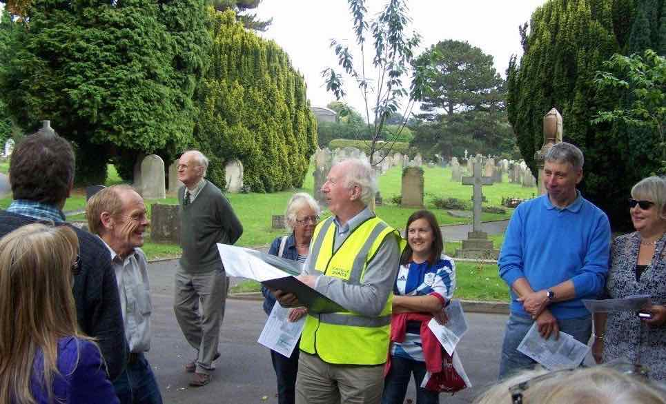 sharing a story at the cemetery